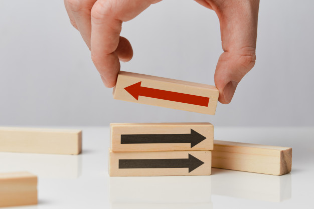 concept thinking differently hand holds wooden block with arrow 102583 2230